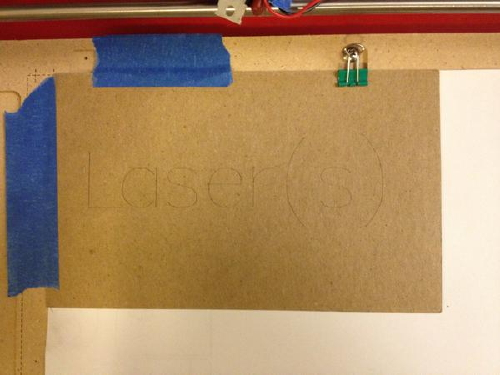 Paperboard marked with the word Laser(s)