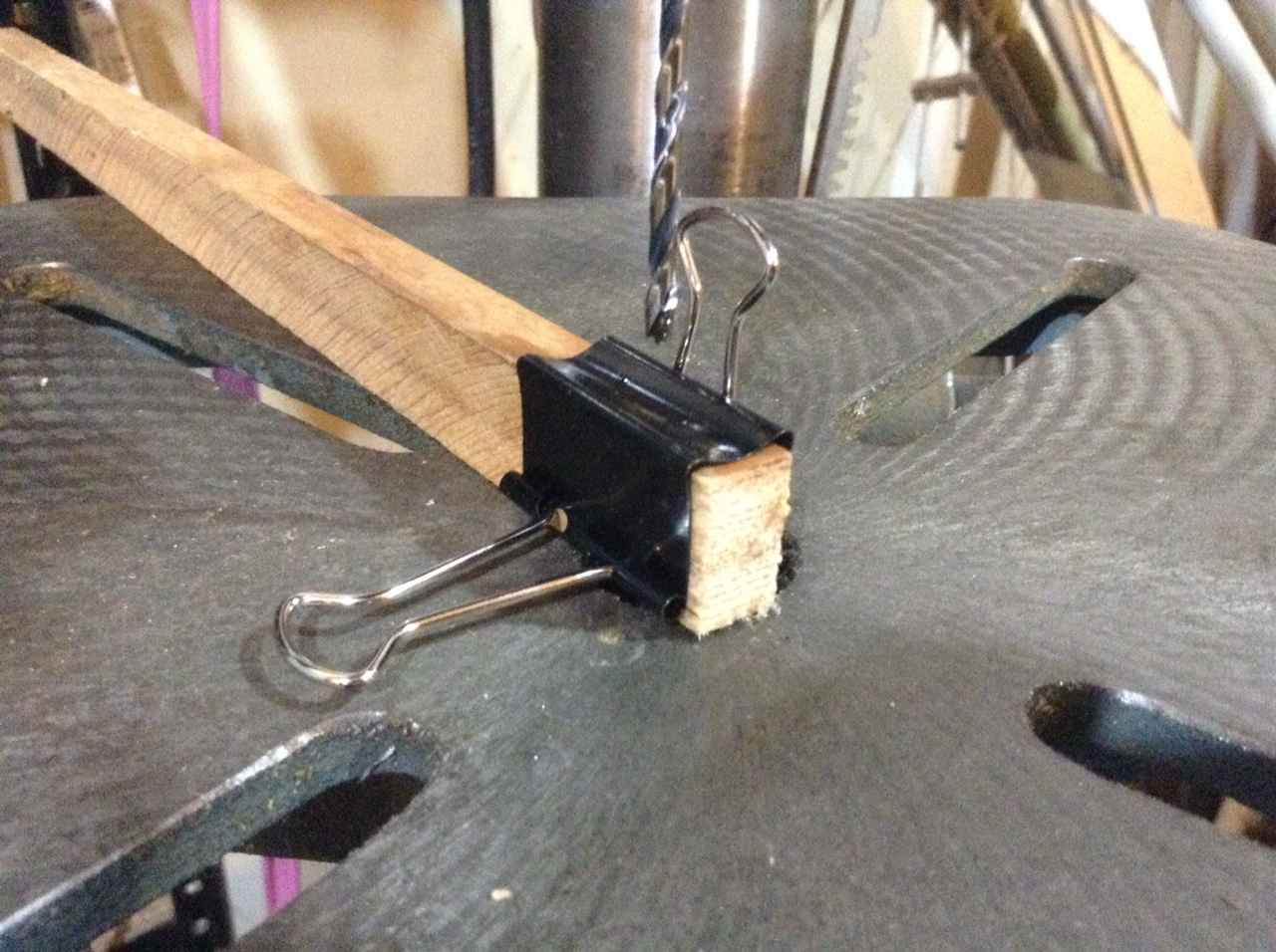 Binder clip on wood piece for drilling