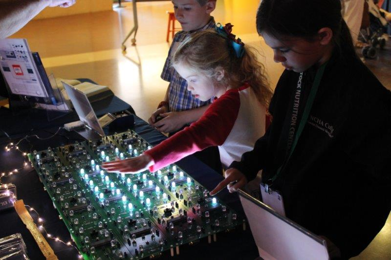 Kids interacting with LEDs