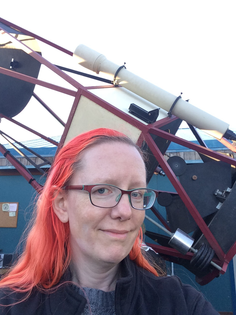 Lenore with telescope behind