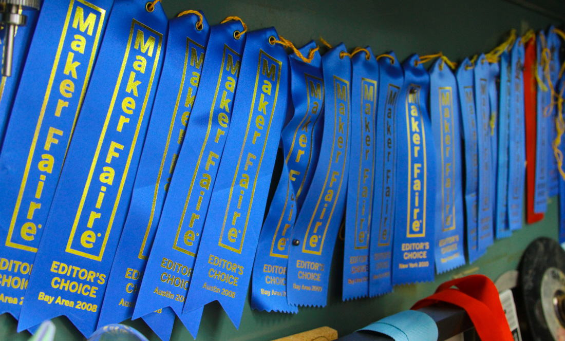 maker faire ribbons being displayed in a cabinet
