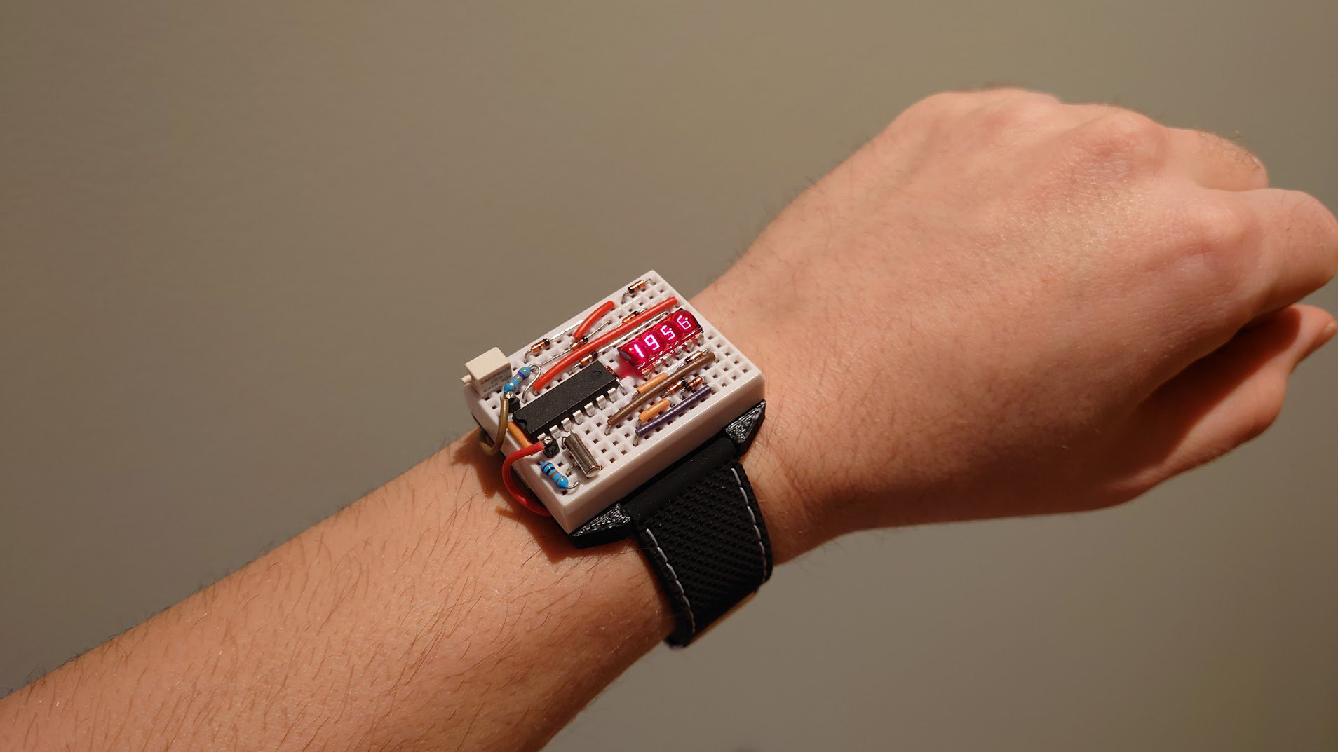 Electronic breadboard wristwatch on an arm