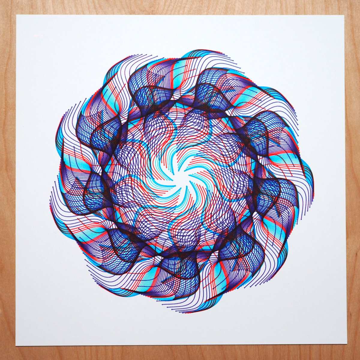 radial design in blues and red on white paper